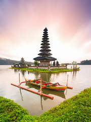 A beautiful sunrise at Pura Ulun Danu Bratan Temple, one of famous tourist attraction in Bali , Indonesia. a major Shivaite and water temple on Bali island, Indonesia. culture symbol of Indonesia.
