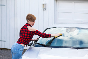 Girl wash a car