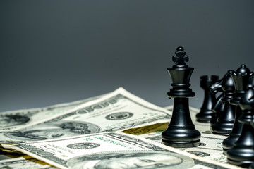 King of chess on dollar background.