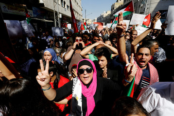Jordanian protesters chant slogans during a protest against a government agreement to import natural gas from Israel, in Amman