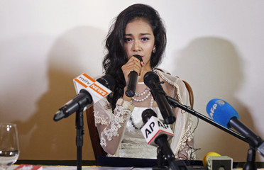 Myanmar's former beauty queen May Myat Noe gives a news conference at a restaurant in Yangon