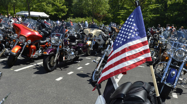 An American flag is displayed on the back of motorcycle in Fairfax