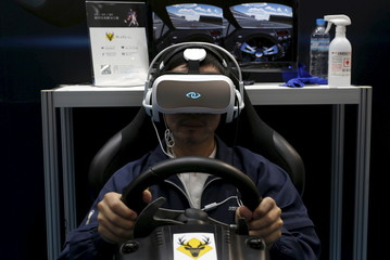 A man tries 3Glasses D2 Vanguard by China's Virtual Reality (VR) Technology Limited, during the Spring Computer show in Taipei, Taiwan