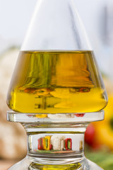 Poster Kitchen Olive oil bottle in the kitchen with magnification of vegetables