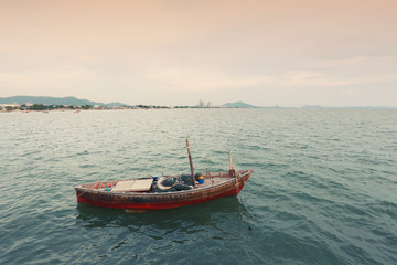 Old fishing boat on the sea coast of Thailand.