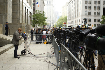 A member of the media places his microphone on a stand outside the New York State Supreme Courthouse waiting for the possible release of former IMF chief Dominique Strauss-Kahn before a bail hearing in New York