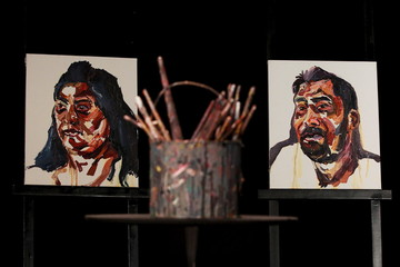 Artwork and paint brushes used by executed Australian drug trafficker Myuran Sukumaran are placed on stage during his funeral at a church in Sydney