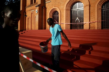 A man paints the stairs in front of the Notre Dame Immaculate Conception Cathedral, where Pope Francis will visit, in Bangui, Central African Republic