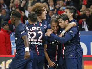 Paris St Germain's Lucas celebrates with team mates his goal against Olympique Marseille during their French Ligue 1 soccer match at the Parc des Princes stadium in Paris