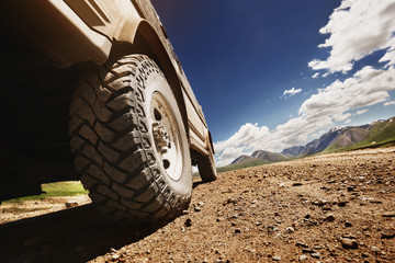 Big offroad car wheel on country road