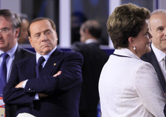 Italy's Prime Minister Berlusconi looks at Brazil's President Rousseff during the G20 Summit in Cannes