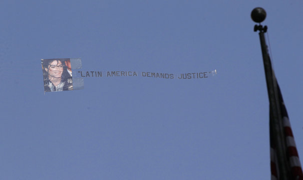 An airplane tows a banner over the Los Angeles Criminal Courts building during Dr. Conrad Murray's trial in the death of pop star Michael Jackson in Los Angeles