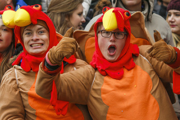 People react as they watch the 88th Macy's Thanksgiving Day Parade in New York