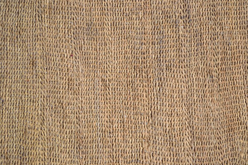 Mat woven from natural material, background