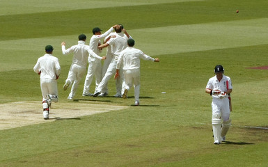 England's Collingwood walks off the field after he was dismissed by Australia's Beer during the fifth Ashes cricket test at the Sydney Cricket Ground