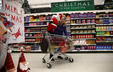 A woman shops at a Sainsbury's store in London, Britain