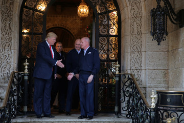 U.S. President-elect Donald Trump shakes hands with Pentagon officials after a meeting at Mar-a-Lago estate in Palm Beach