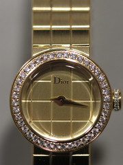 """A Dior logo is seen on """"La Mini D de Dior"""" watch displayed on the watchmaker's showcase at the Baselworld in Basel"""