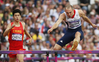 David Greene (R) of Britain and Cheng Wen of China compete in their men's 400m hurdles during the London 2012 Olympic Games at the Olympic Stadium