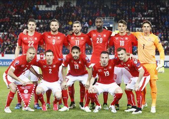Switzerland's national team pose before the Euro 2016 Group E qualifying soccer match against Estonia at Swisspore arena in Luzern
