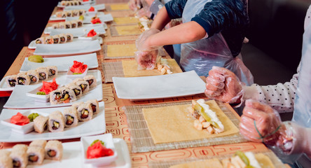 Children prepare sushi and rolls