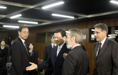 China's Commerce Minister Chen Deming attends a meeting with Brazil's Foreign Minister Antonio Patriota and Brazil's Commerce Minister Fernando Pimentel in Brasilia