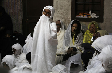 Ethiopian Orthodox worshipers pray before the Washing of the Feet ceremony at the Church of the Holy Sepulchre in Jerusalem
