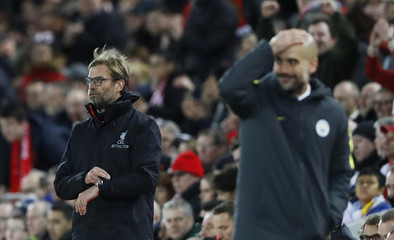 Liverpool manager Juergen Klopp and Manchester City manager Pep Guardiola
