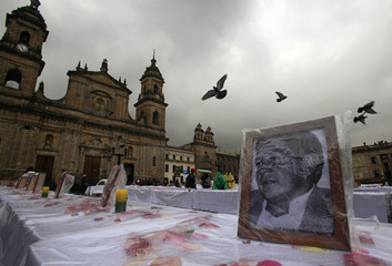 A photograph of victim missing or killed in armed conflict in Colombia is displayed during a tribute at Bolivar Square in Bogota