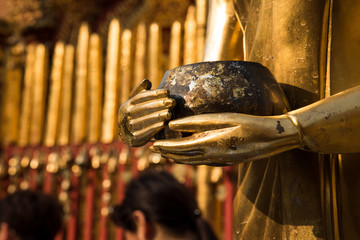 close up hand of buddha statue golden in religious buddhist ..beautiful architecture and sculpture since ancient.