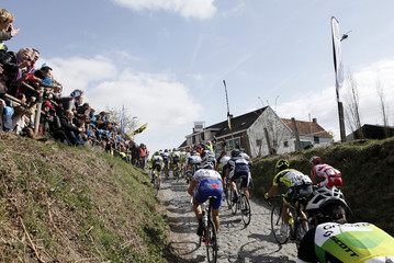 A pack of riders cycles up the Koppenberg during the 96th Ronde van Vlaanderen UCI World Tour cycling race in Oudenaarde