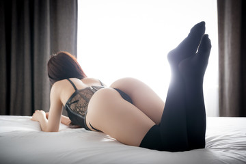 Beautiful ass butts woman in black knee socks on bed at home