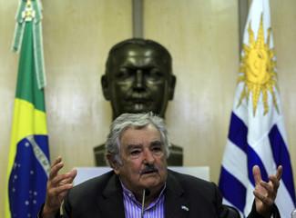 Uruguay's President Jose Mujica gestures as he attends a Brazil-Uruguay business meeting in Sao Paulo