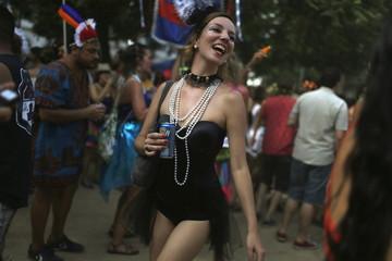 """A reveller takes part in an annual block party known as """"Cordao de Prata Preta"""" in Rio de Janeiro"""