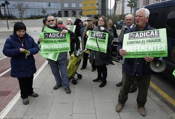 Shareholders protest before Bankia's annual shareholder meeting of Spain's largest nationalised bank in Valencia