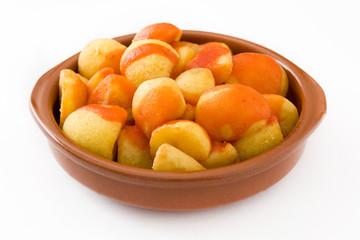 Patatas bravas in bowl isolated on white background