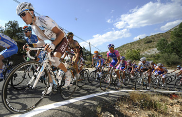 "A pack of riders cycle during the ninth stage of the Tour of Spain ""La Vuelta"" cycling race between Calpe and Alcoy"