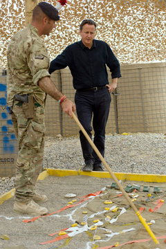 Britain's Prime Minister David Cameron is shown a map of the area during his visit to Camp Bastion in Helmand province, Afghanistan