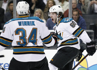 San Jose Sharks' Demers celebrates his goal with Winnik against the Kings during the first period of their NHL hockey game in Los Angeles
