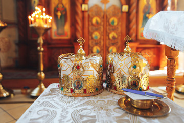 Two beautiful gold wedding crowns in the Church