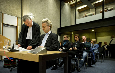 Dutch lawmaker Geert Wilders, charged with inciting hatred against Muslims, sits in a courtroom in Amsterdam