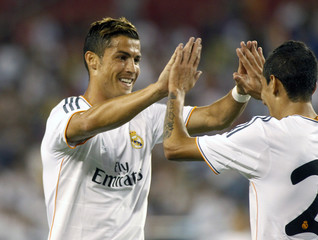 Real Madrid's Ronaldo congratulates DiMaria after his goal against the L.A. Galaxy during their Guinness International Champions Cup soccer match in Phoenix