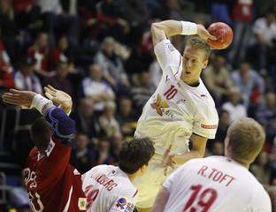 Denmark's Markussen tries to score against Slovakia during their Men's European Handball Championship Group A match in Belgrade