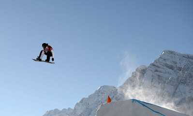 Snowboarder Mark McMorris of Canada performs a jump during slopestyle snowboard training at the 2014 Sochi Winter Olympics in Rosa Khutor