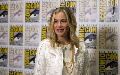"Cast member Applegate poses at a press line for ""Book of Life"" during the 2014 Comic-Con International Convention in San Diego"