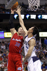 Dallas Mavericks' Yi defends against Los Angeles Clippers' Griffin during their NBA basketball game in Dallas