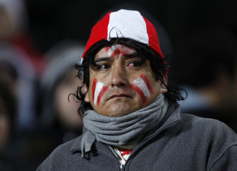 Peruvian fan reacts after Uruguay's second goal in their semi-final soccer match at the Copa America in La Plata