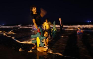 Palestinians play on a Gaza City beach