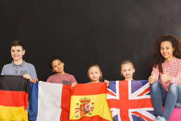 Smiling kids holding flags