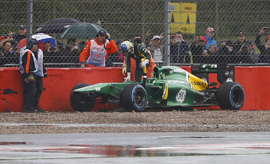 Caterham Formula One driver Pic of France climbs out of his car after sliding off track during first practice session for British Grand Prix at Silverstone Race circuit